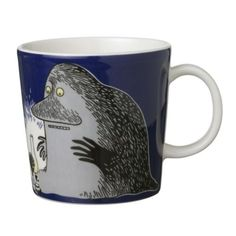 """This dark blue Moomin mug by Arabia from 2005 features the Groke looking at a night light. It's beautifully illustrated by Arabia artist Tove Slotte-Elevant and the illustration can be seen in the original book """"Moominland Midwinter"""" by Tove Jansson. Moomin Shop, Moomin Mugs, Porcelain Mugs, Ceramic Cups, Tove Jansson, Tea Cup Set, Tea Art, Marimekko, Mug Cup"""