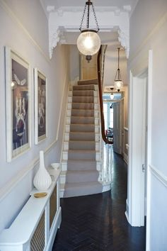 Narrow white hallway in 2019 hallway lighting ideas небольши Stairway Lighting, Hall Lighting, Lighting Ideas, Lighting Design, Entryway Lighting, White Hallway, Modern Hallway, Hallway Ideas Entrance Narrow, Front Hallway