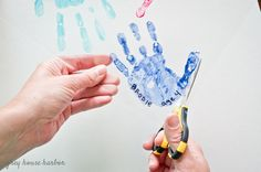 Paint your child's entire hand. Coat it well enough to be all wet, but not so drippy that you loose the details of the print. Easy Mother's Day Crafts, Cute Kids Crafts, Daycare Crafts, Diy Arts And Crafts, Crafts To Do, Homemade Fathers Day Gifts, Diy Gifts For Dad, Dad Gifts, Fathersday Crafts