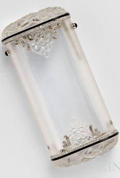 Art Deco Carved Rock Crystal Cigarette Box, Retailed by Charlton & Co., the carved rock crystal box with floral and foliate motifs, platinum and rose-cut diamond frame with millegrain accents, 18kt gold mount, lg. 3 1/2 in., French maker's mark and guarantee stamp, marked MADE IN FRANCE, in original fitted box.