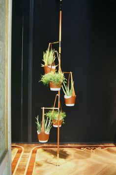 Wallpaper* Magazine: Salone del Mobile 2015, Luis Vuitton: Damien Langlois-Meurinne's new pieces for Louis Vuitton comprise a valet stand and 'Totem Floral'(pictured) - a device for displaying pot plants