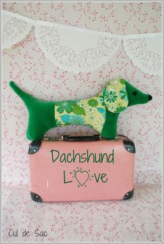 Eco-friendly stuffed sausage dog made with upcycled materials