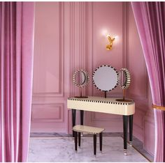 """Happy to represent Scarlet Splendour and its beautiful lines. Here """"Woman in Paris"""" dressing table, and """"Luce Naga"""" a brass sconce with Murano glass. Both designed by Matteo Cibic"""