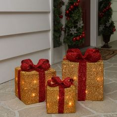 "Description:Nothing says holiday like gift boxes wrapped in bows. Adding some illumination will give your yard that special touch. Place on porches, lawn or have them inside to create the perfect seasonal setting. Product Features:%3C/b Gold tinsel gift boxes wraped with red bows Pre-lit with a total of 35 clear lights Bulb size: mini 71"" white lead cord Includes: (1) 5.25""H x 6""W x 6""D, 8-light gift box (1) 7""H x 8""W x 8""D, 12-light gift box (1) 9""H x 10""W x 10""D, 15-light gift box Ad.. Christmas Lamp Post, Hanging Christmas Lights, Christmas Yard Art, Snowman Christmas Decorations, Decorating With Christmas Lights, Christmas Diy, Holiday Lights, Holiday Decorating, Red Gift Box"
