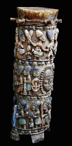 A superbly populated Ogboni cult ritual drum by George Bamidele Areogun. Between 1940 - 42 the Ogboni cult commissioned Bamidele to carve ritual implements especially ritual drums for the cult's Iposi Ekiti compound. Indian Musical Instruments, African Life, African Drum, Tribe Of Judah, African Sculptures, Orisha, Soul Art, African Masks, African Design