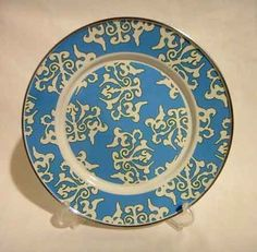 "Golden Rabbit Enamelware Blue Damask Dinner Plate by Golden Rabbit. $12.99. Stainless steel rim for greater durabilty. 10.5"" enamelware dinner plate with stainless steel rim. Design is very light blue with a thin green outline against a bright white background. From Golden Rabbits Damask Collection by Laura Fair. Enamelware is not intended for microwave use. Oven, freezer, and dishwasher safe. Do not leave in standing water. Dry promptly. Made from carbon steel coated with porcel..."