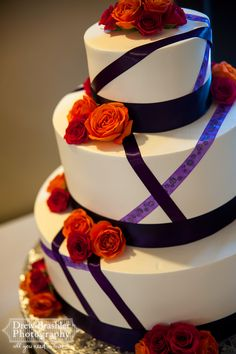 Venue at the Grove- Unique 3 tiered wedding cake with purple ribbon.