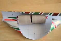 Supplies for New Year's Eve Poppers:    4 inch paper tube – paper towel roll or empty wrapping paper tube  scissors and tape  wrapping paper – use those leftover pieces from presents  curling ribbon  candy and confetti