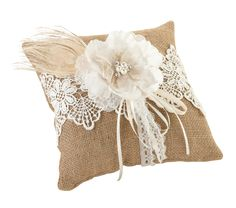 This rustic burlap pillow combines elements of lace, a natural peacock feather, ribbons and flower with pearl/rhinestone decoration in the center. It will be hard to find a ring pillow with a more bea