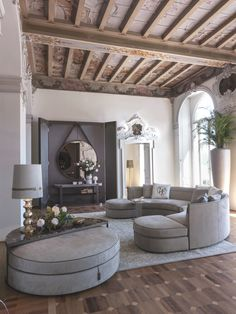 The Borromeo sofa: the shape of elegance  A creation that is truly one of a kind, a perfect circle with its matching ottoman, almost like an island of softness