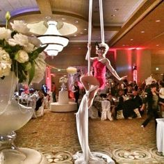 When asked to provide a Gatsby inspired aerial artist, J&D Entertainment had the perfect costume! Don't be afraid to ask for custom options, we will make your visions come to life! Houston aerial silks performer www.jdentertain.com