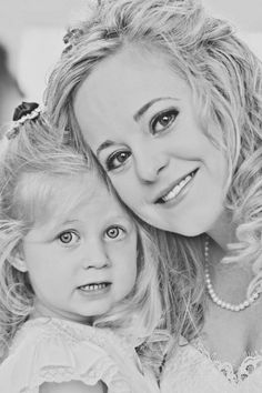 Traditional flower girl and bride photo in black and white