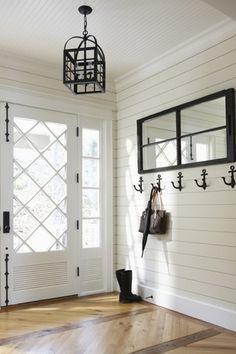 Cottage Entryway with Crown molding, Anchor wall hook, Glass panel door, Chandelier, Hardwood floors