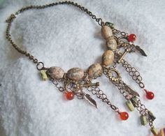 Earthy tones of Jasper, Agate, Yellow Turquoise, and Antique Brass Necklace. $30.00, via Etsy.