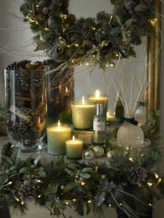 Love the mix of celery green, silver, pine cones, and the candle light w/evergreen!