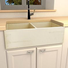 """The mild wheat finish of this fireclay farmhouse kitchen sink intermingles tastefully with antique streaks. Supplementing the form with function are the dual bowls used to separate products before readying food. This product was fashioned in an old Italian village renowned for ceramics found in royal palaces. 32 3/4"""" L Farmhouse Apron Sink, Italian Village, Palaces, Kitchen Sink, Separate, Bowls, Ceramics, Antique, Storage"""