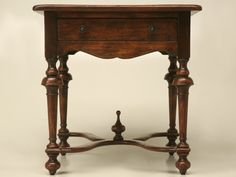 Solid wood side table with drawer, X-stretcher and finial. This table has a very authentic antique appearance due to the distressed finish. This is a high-quality table at an affordable price and with a hard-wearing, durable finish.