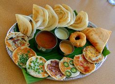 A platter of small dosas, 7 different uthappams and a vada. Southern Indian cuisine. #food #India