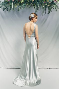 Backless silver wedding gown by Kate Beaumont