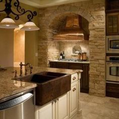 Tuscan Kitchen With Stone Wall Over The Range And Copper Hood And White Island With Quartz Countertop , Timeless Tuscan Kitchen In Kitchen Category