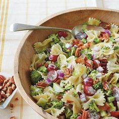 1 cup chopped pecans 1/2 (16-oz.) package farfalle (bow-tie) pasta 1 pound fresh broccoli 1 cup mayonnaise 1/3 cup sugar 1/3 cup diced red onion 1/3 cup red wine vinegar 1 teaspoon salt 2 cups seedless red grapes, halved 8 cooked bacon slices, crumbled 1.
