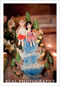 hiking wedding cake bride and groom on top of mountain with waterfall