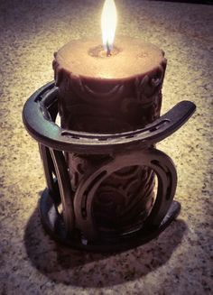 Gorgeous custom made horse shoe candle holder, perfect for any home! Found under Fractured welding at etsy.com-SR #Horseshoecrafts