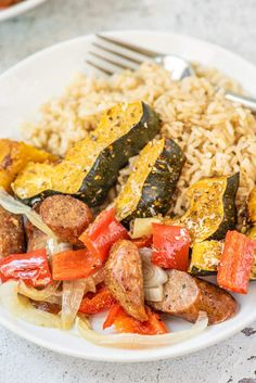 This amazing six ingredient Sheet Pan Sausage dinner with roasted acorn squash, bell peppers, and sweet onions is delicious, healthy, and couldn't be easier to make. #dinner #quickandeasy