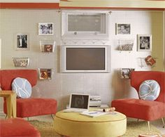 Basement Wall Idea: Cover the Wall with Pegboard Panels of white-painted pegboard add funky texture to the wall of this retro-style basement. With the help of hanging hardware designed for pegboards, you can decorate the wall with photos as well as baskets for DVDs and magazines.