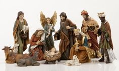 """8"""" Heaven's Majesty Nativity Figure Set   Wood carved look, hand-painted in traditional colors. Beautiful 11 piece heirloom quality nativity set. Removable Baby Jesus! This stunning Nativity has some of the finest detail we've seen! The faces on these figures are painted with great care and the quality is visible. Figures are 8"""" tall. (Item #22530) $120.00  SALE! NOW $110.00  While supplies last or thru 12/24/12."""