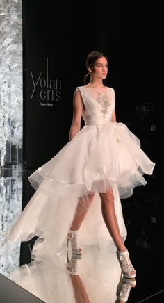 Yolan Cris high low hem wedding dress