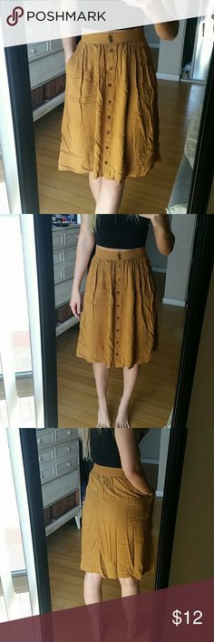 F21 mustard midi button down skirt This skirt is fantastic. Although it wrinkles way too easily it is one of my favorite skirts! Selling because yellow doesn't exactly go with my blonde hair in my opinion. Color is a deep mustardy brown. Forever 21 Skirts Midi