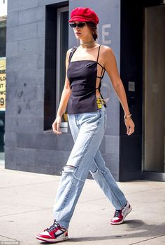 Bella Hadid puts on quite a sideshow in racy navy top | Daily Mail Online