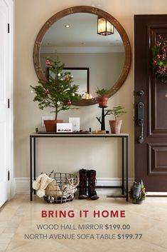 Welcome your holiday guests to a festive and inviting entryway with small holiday accents on a stylish table.   Featured Products: Wood Hall Mirror, North Avenue Sofa Table, Metal Candleholder, Galvanized Tray, Metal Basket, Dog Statuary.