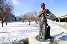 Knitting group drops yarn bombs on Waterloo statues