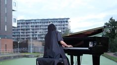 HJ Lim playing Rachmaninov on a Yamaha SH Silent Piano as dawn breaks along Regents Canal
