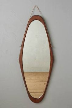 Midcentury-style polished wood mirrors from Anthropologie