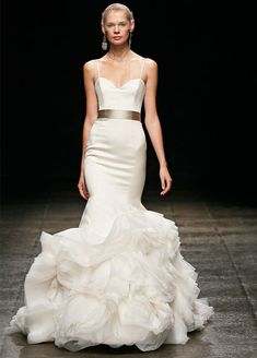 Ivory organza flounce mermaid bridal gown, sweetheart neckline with thin straps at shoulder, silk satin organza elongated bodice, asymmetrical layered skirt, chapel train. Taupe silk ribbon at natural waist sold separately. (JLM Couture - Lazaro)