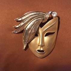 Pin.  Price reduction 5/20 Pin in gold of a women's face with a rhinestone.  It's a fun looking pin on a jacket. Other