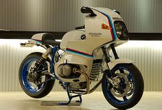 In the mid-70s, the BMW R100RS was the most radical motorcycle you could buy. It was BMW's answer to the relentless threat of large-capacity Japanese motorcycles, and it came with a seven-part fairing—a new style of bodywork that reportedly reduced side wind deflection by 60% over the standard S model. But it looked a little…