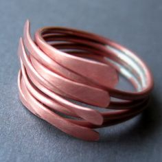 Copper Kalimba ring by BeadsInTheBelfry on Etsy - hammered copper and soldered at back with silver