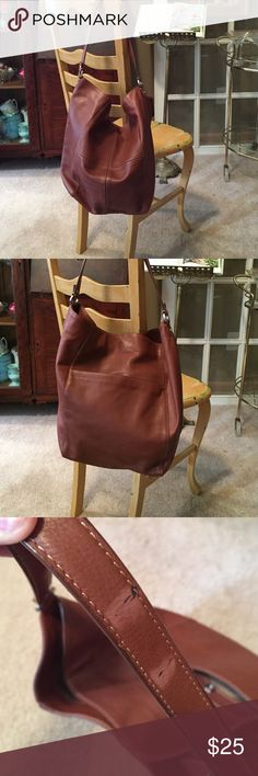 Brown leather tote Liz Claiborne leather tote. Soft leather...bag is in great condition except for two fade marks on handle. Pls see 3rd photo. Inside is spotless. Liz Claiborne Bags Totes