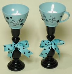 """Retro Candlesticks  As seen in """"The Crafters Guide to Glue""""  Designed by Pattie Donham    Supplies:    2 Reclaimed coffee cups  2 Wood candlesticks, painted black  Adhesive gel  Adhesive craft dots  Polka dot ribbon  Black buttons  Permanent black marker  Small rubberstamps  Black permanent ink pad  Black Embossing Powders  Alcohol  Paper Towel  Heat gun  Tea lights  Steps:    Clean the cups with alcohol and wipe dry with paper towel.  Rubberstamp the cups with permanent ink. Sprinkle with b..."""