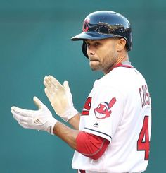 Welcome back  CoCo Crisp. CoCo's first at bat as being an Indian again hits a double off the left field wall against the Miami Marlins, clapping at 2nd base, first inning, at Progressive Field  on September 3, 2016. Indians won 8- 3   (Chuck Crow/The Plain Dealer)