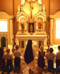 """Introibo Ad Altare Dei: unless ye become like little children, ye shall not enter the Kingdom of Heaven. A good reason to kneel for Holy Communion: to learn to become like the little ones of the Gospel; to prepare ourselves to receive the Word. For those who insist  that """"standing for Communion is symbolic of being raised up in Christ"""": if this is an actual concern, then doesn't *kneeling* for Communion and then standing up to return to one's pew communicate that far more effectively?"""