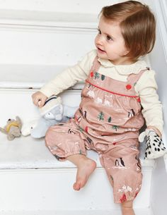 Have fun with your little one in our quirky dungarees. They're lined with soft cotton jersey to keep your baby feeling cosy and warm from playtime to naptime. And the popper details and adjustable straps make emergency changes a doddle.