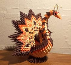 This turkey was made using modular origami techniques. Over 800 small triangles were made and assembled. Please choose 3 colors. Great present for Thanksgiving