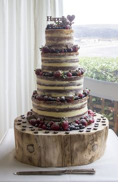 Naked Wedding Cake. Beautiful Wedding Cakes made to order in Swansea and South Wales. Custom made design to your specific needs. Looking elegant and tasting delicious. Please contact me with any questions or to arrange a consultation.