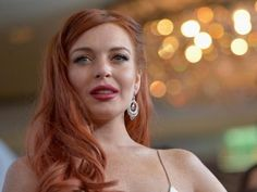 "Lindsay Lohan was reportedly very drunk when she punched a girl over Max, the singer from ""The Wanted"" band, which resulted in her arrest."