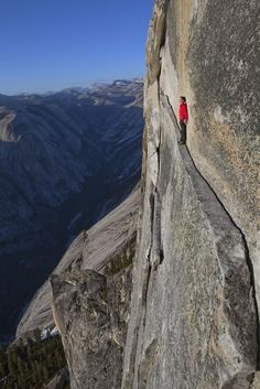 """This 40-foot-long sliver of granite on Half Dome, named the Thank God Ledge, is the only way to get beyond the Visor, a massive roof that looms over the Regular Northwest Face route. Most people crawl, says Alex Honnold, but he prefers to walk it, face out, since that's """"cooler."""" The 30 seconds it takes to get across requires absolutely no technical climbing skill, but even Honnold admits it's sobering to look at 1,800 feet of air."""